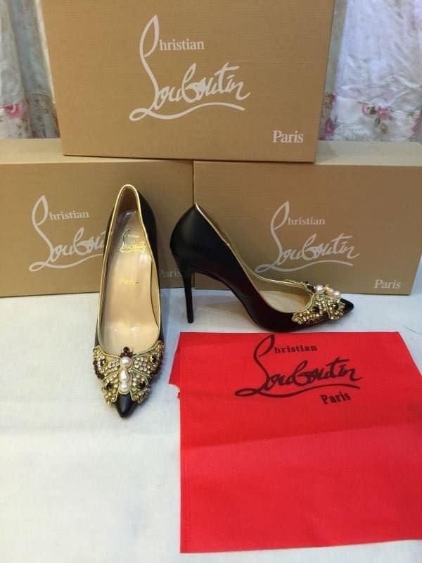 Christia Louboutin shoes and logo